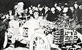 Camille du Gast, seul concurrent à la voiture fleurie, à son arrivée nocturne du Paris-Madrid 1903.jpg
