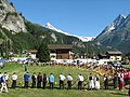Camping Evolene folklore Hornfestival with some 100 hornplayers at 15 july 2007, as organised every few years. In the background Dent Blanche 4357m - panoramio.jpg