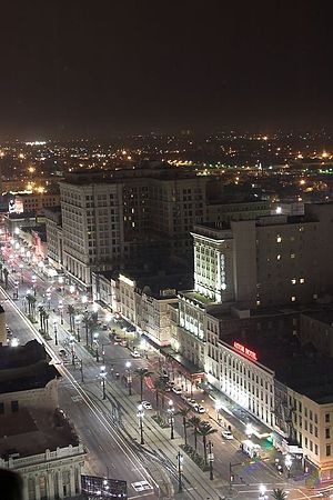 Canal Street, New Orleans - Canal Street at night 2006, same view as the 1920s depiction, looking toward Mid-City
