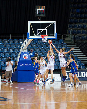 Women's National Basketball League - WNBL teams, the Logan Thunder in white and the University of Canberra Capitals in blue, battle for the ball in a game on 20 January 2012