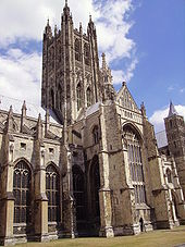 The tower at Canterbury is seen rising high above one of the transepts. It is in two stages, with pairs of tall arched windows in each stage. At the four corners are buttresses which are much ornamented and terminate in four large carved pinnacles.
