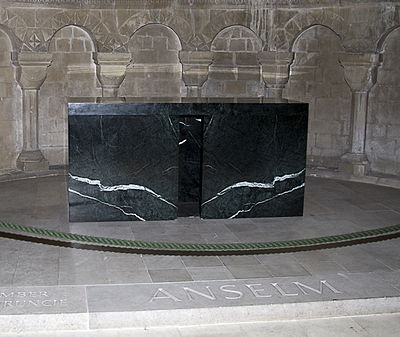 The Altar of St Anselm in his chapel at Canterbury Cathedral. It was constructed by English sculptor Stephen Cox from Aosta marble donated by its regional government and consecrated on 21 April 2006 at a ceremony including the Bishop of Aosta and the Abbot of Bec. The location of Anselm's relics, however, remains uncertain. Canterburycathedralanselmtomb.jpg