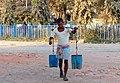 Carrying Water (14846619592).jpg