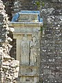 Caryatid fireplace at Raglan Castle.jpg
