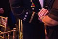 Chairman of the Joint Chiefs of Staff U.S. Army Gen. Martin E. Dempsey, left, holds hands with a surviving military family member March 27, 2014, during the 2014 Tragedy Assistance Program for Survivors (TAPS) 140327-D-KC128-534.jpg