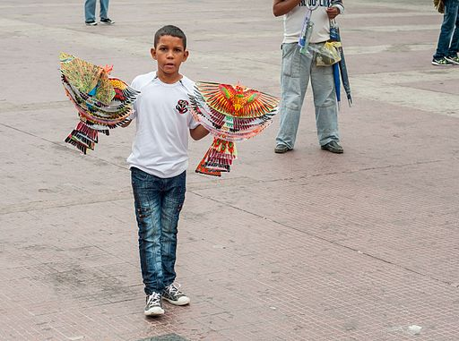 Child selling toys in the street