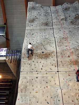 Håkons Hall - A climber ascending the wall.