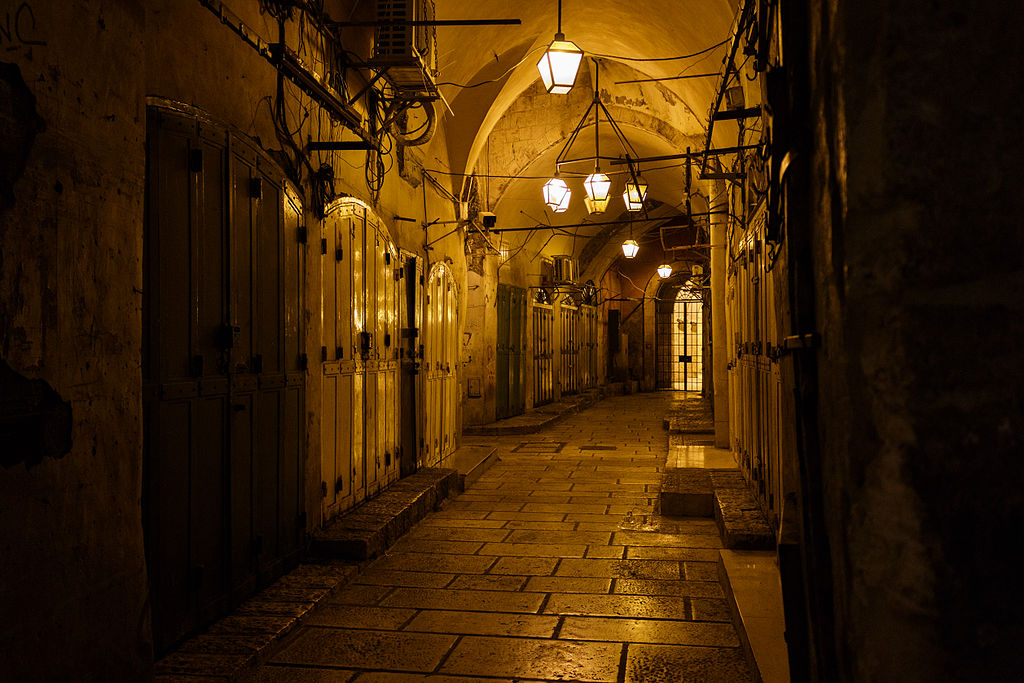 Golden lights illuminating an closed alleyway