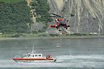Coast Guard MH-60 Jayhawk helicopter crew conducts a hoist demonstration in Kodiak, Alaska 130725-G-FO900-035.jpg