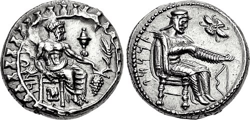 Silver coin of Achaemenid satrap (governor) Datames, minted in Tarsus, dated c. 375 BC. Obv: The God Baaltars seated. Rev: Datames wearing Persian dress, inspecting arrow held in hands. Winged solar disk to the upper right. Coin Datames.jpg