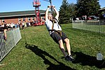 Col. Gary Fleming, wing commander of the Pennsylvania Civil Air Patrol Wing, takes a turn on the mobile zip line.jpg