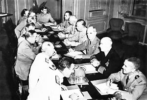 Combined Chiefs of Staff - Combined Chiefs of Staff in Quebec – August 23, 1943. Seated around the table from left foreground: Vice Adm. Lord Louis Mountbatten, Sir Dudley Pound, Sir Alan Brooke, Sir Charles Portal, Sir John Dill, Lt. Gen. Sir Hastings L. Ismay, Brigadier Harold Redman, Comdr. R.D. Coleridge, Brig. Gen. John R. Deane, General Henry Arnold, General George Marshall, Admiral William D. Leahy, Admiral Ernest King, and Capt. F.B. Royal.