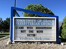 "A church sign reading: ""STAND WITH BROOKWOOD! NOT ONE MORE VICTIM!"""