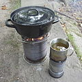 Cooking potatos on a large hobo stove 03.jpg