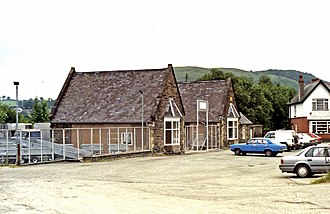 Corwen railway station - The main station building in 1992, showing the demolished wings and central section, about to be redeveloped as a showroom