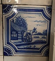 Cow & milkmaid Delft tile.JPG