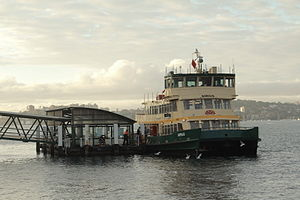 Cremorne Point Ferry Wharf being visited by a ferry.