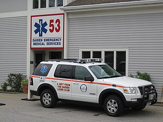 Emergency medical services in the United States - This medical services headquarters in Darien, Connecticut has an emergency vehicle outside ready to respond immediately in case of need.
