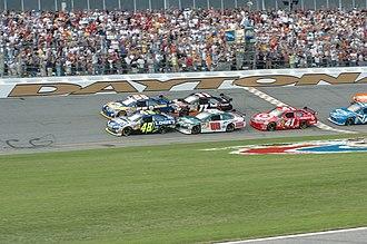 Daytona 500 history - Start of the 2008 Daytona 500. The inside cars are Jimmie Johnson (No. 48), Dale Earnhardt, Jr. (No. 88), and Reed Sorenson (No. 41). The outside cars are Michael Waltrip (No. 55) and Denny Hamlin (No. 11).