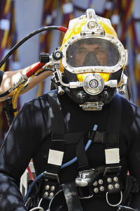 Defense.gov News Photo 110612-N-WL435-365 - Chief Petty Officer Billy Goold assigned to Commander Task Group 56.1 prepares for a dive salvage project in Umm Qasr Iraq on June 12 2011.jpg