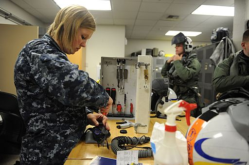 Defense.gov News Photo 110616-N-VE240-057 - U.S. Navy Airman Jessica Tescher left a parachute rigger performs a monthly maintenance check on a pilot s helmet during Exercise Northern Edge