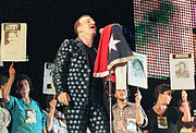 The families of Detenidos Desaparecidos join U2 on stage during a performance in Santiago, Chile on the PopMart Tour in 1998.