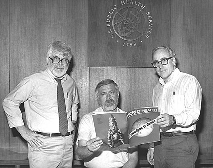 Three former directors of the Global Smallpox Eradication Program read the news that smallpox had been globally eradicated, 1980. Directors of Global Smallpox Eradication Program.jpg