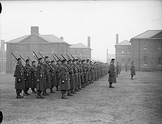 Military history of Canada during World War II - The Toronto Scottish Regiment on parade in Aldershot, UK, December 1939. Canada's initial commitment to the war was one division, with another in reserve for home defence.