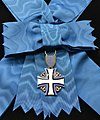 EST Order of the Cross of Terra Mariana 1st class badge for ladies.jpg