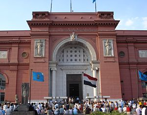 Supreme Council of Antiquities - Main entrance of the Museum of Egyptian Antiquities; the flag of the Supreme Council of Antiquities can be seen on both sides of the Egyptian flag