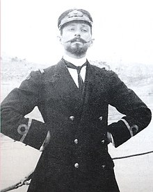 An imperious young man in Greek naval uniform