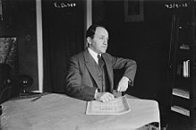Ernest Bloch in 1917 at a table.jpg