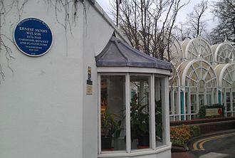 Birmingham Botanical Gardens - Wilson's blue plaque, with the gardens' main entrance in the background