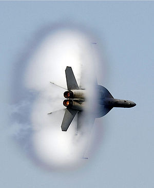 Supersonic speed - A United States Navy F/A-18F Super Hornet in transonic flight