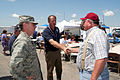 FEMA - 30665 - State and local officials and FEMA shake hands at luncheon in Kansas.jpg