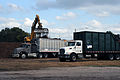 FEMA - 38828 - Trucks being loaded with chipped storm debris.jpg