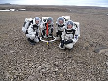 Crew members Brian Shiro, Christy Garvin, Stacy Cusack and Kristine Ferrone deploy the TEM47-PROTEM low frequency electromagnetic survey equipment on Haynes Ridge during EVA 8.