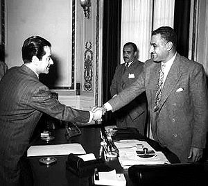 Farid al-Atrash - Al-Atrash shaking hands with Egyptian president Gamal Abdel Nasser, February 1955