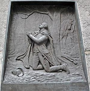 English: A brass relief of George Washington k...