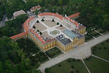 Areal view of a palace around a large courtyard