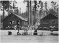 Fire school at the Coyote Creek CCC Camp. Pete Whitelaw is lecturing on use of the double-bitted axe. Superintendent... - NARA - 298704.tif