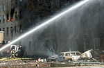 Firefighters work to put out the flames moments after a hijacked jetliner crashed into the Pentagon at approximately 0930 on September 11, 2001 010911-M-CI426-071.jpg