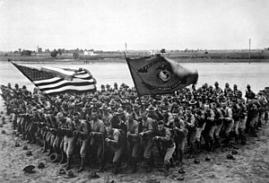 Flying wedge - United States Marines pose in a wedge formation in 1918.