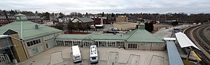Fitchburg (MBTA station) - The bus bays, waiting room, and commuter rail platform seen from the garage roof