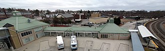 Fitchburg Intermodal Transportation Center - The bus bays, waiting room, and commuter rail platform seen from the garage roof