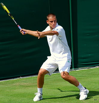 Mikhail Youzhny - Youzhny during his first round match at 2011 Wimbledon against Argentine Juan Mónaco. He would win the match in five sets.