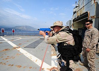 NATO Maritime Interdiction Operational Training Centre - Image: Flickr Official U.S. Navy Imagery A boarding team member practices small arms tactics