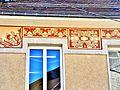 Fresques sur la façade de la mairie.jpg