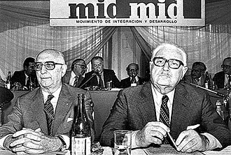 Integration and Development Movement - Frondizi and Frigerio chair a MID convention during the 1983 elections. The party fared poorly, and in later years joined coalitions.