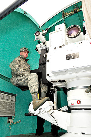 Cinetheodolite - The Air Force Space Command commander sits in a cinetheodolite at the Cape Canaveral Air Force Station